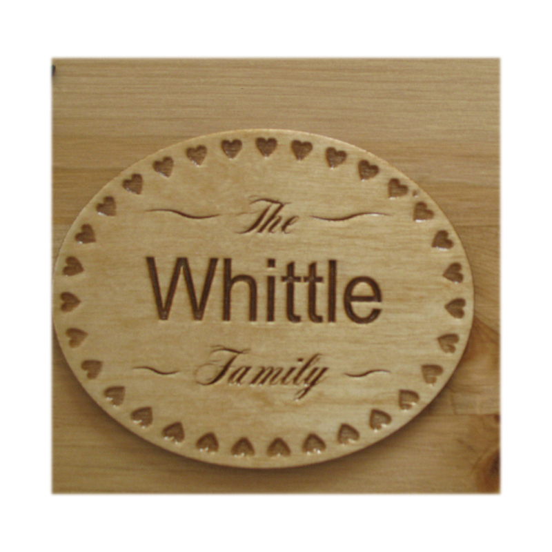 Oval engraved wood nameplate with hearts border